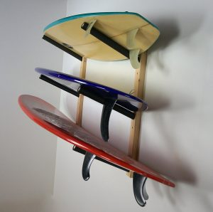 three surfboards on a rack