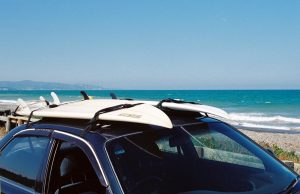 car with two surfboards on the roof