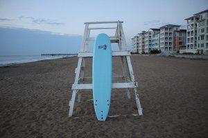 rock it beginner surfboard standing on a beach