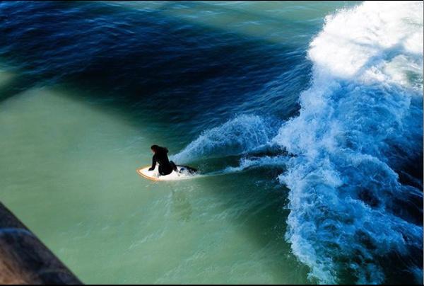 surfing under the jetty